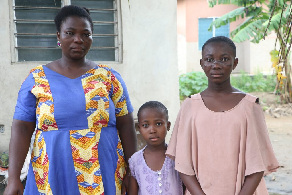 Esther Hodo left beside their mother and Esi Fiatse on the right.